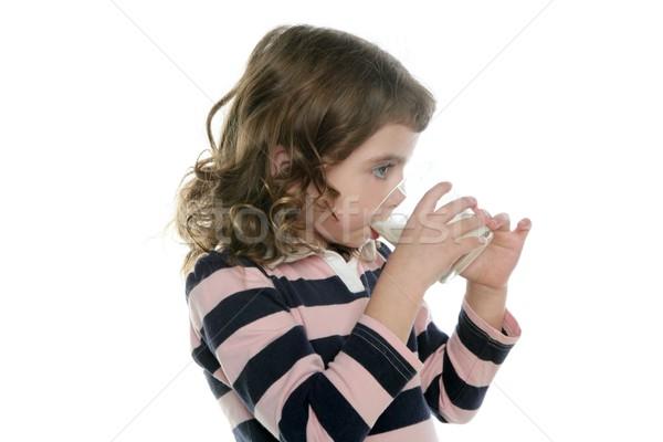 brunette little girl drinking glass of milk Stock photo © lunamarina