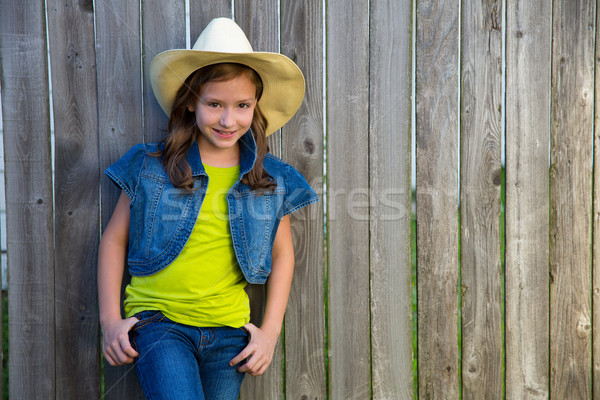 Children girl as kid cowgirl posing on wooden fence Stock photo © lunamarina