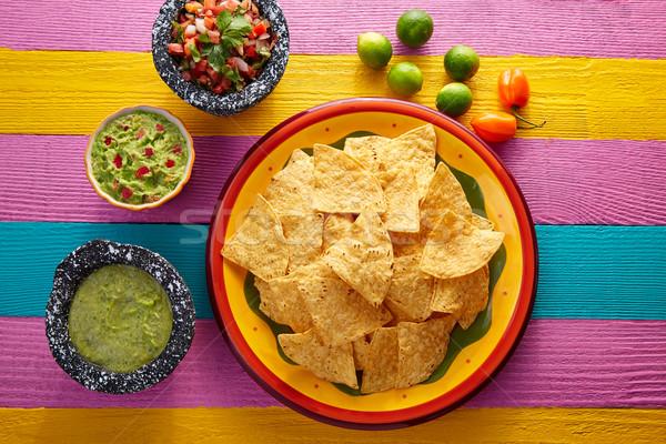 Nachos tortilla sültkrumpli mexikói színes asztal Stock fotó © lunamarina