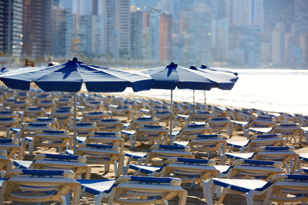 Benidorm sunrise with hammocks and parasol  Stock photo © lunamarina