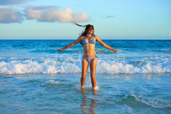 Latin bikini girl jumping in Caribbean beach Stock photo © lunamarina
