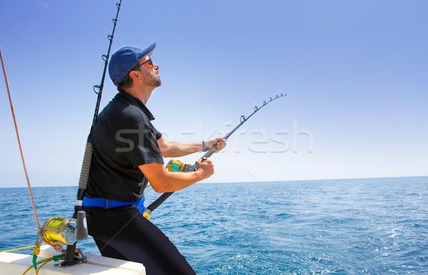 blue sea offshore fishing boat with fisherman Stock photo © lunamarina