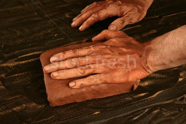 artist man hands working red clay for handcraft Stock photo © lunamarina