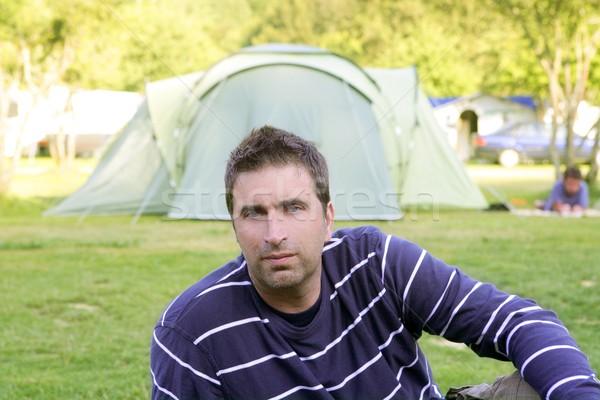 Caucassian man relaxed on camping meadow Stock photo © lunamarina