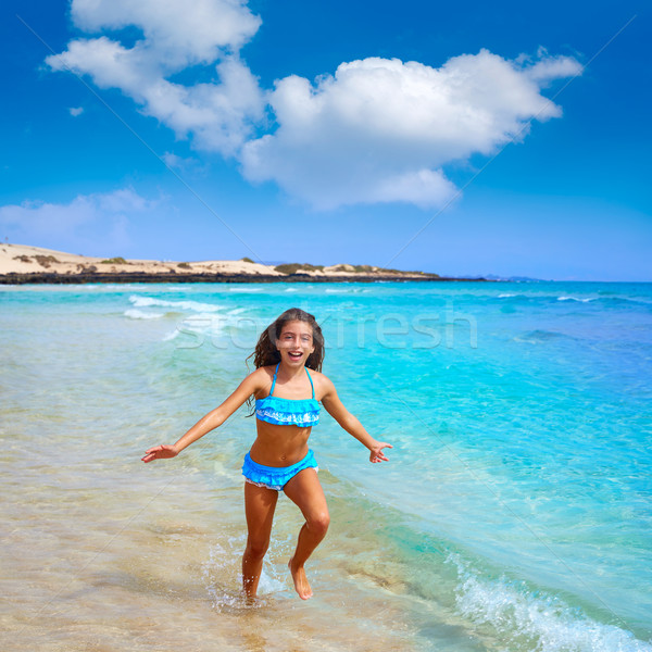 Girl on the beach Fuerteventura at Canary Islands  Stock photo © lunamarina