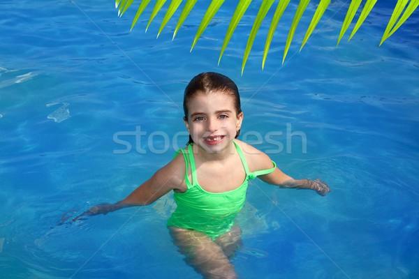 brunette pool littke girl smiling missing front teeth Stock photo © lunamarina