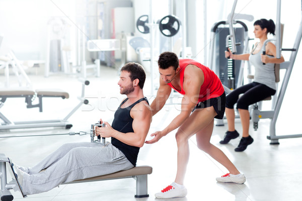 Ginásio homem personal trainer mulher da aptidão mulher corpo Foto stock © lunamarina