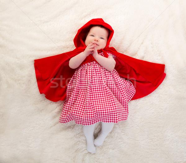 Baby Little Red Riding Hood on white fur Stock photo © lunamarina