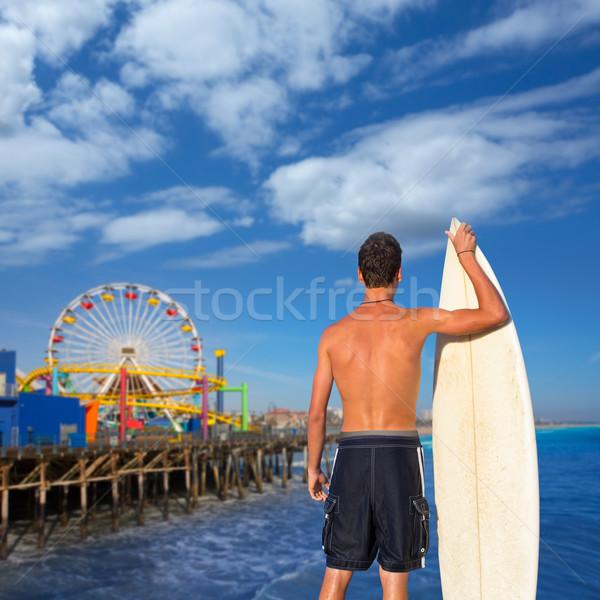 Boy surfer back view holding surfboard on beach Stock photo © lunamarina