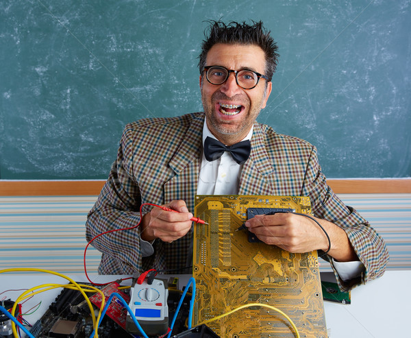 Stock photo: Nerd electronics technician silly expression PCB