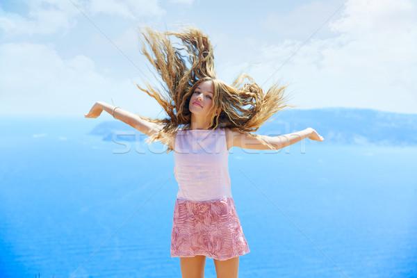 Rubio nina pelo aire azul mediterráneo Foto stock © lunamarina