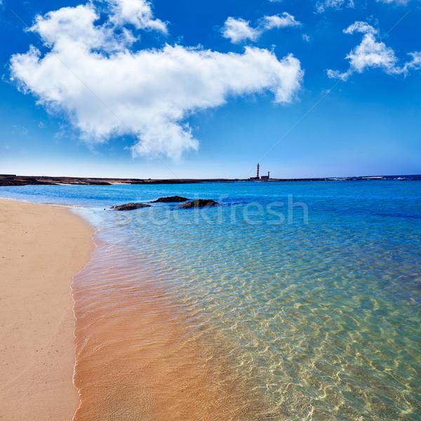 Plage phare ciel eau soleil Photo stock © lunamarina