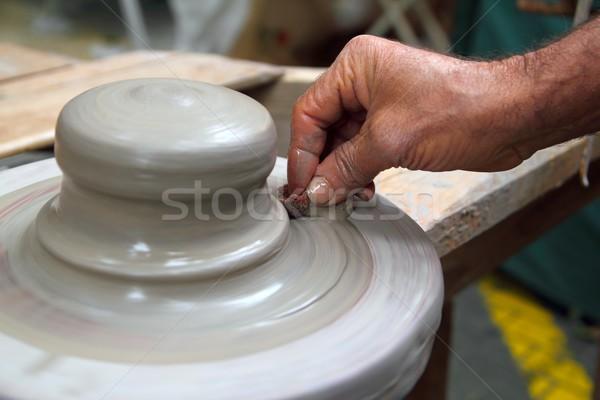 man potter hands working on pottery clay wheel Stock photo © lunamarina