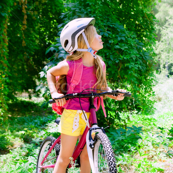 Children girl riding bicycle outdoor in forest smiling Stock photo © lunamarina