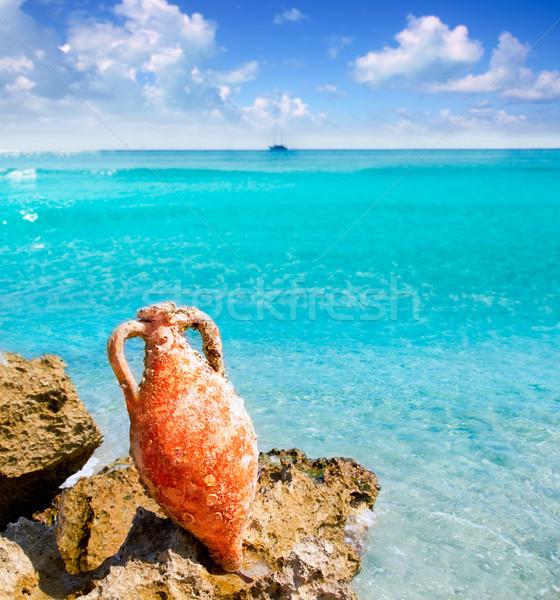 Amphora from roman culture on mediterranean beach Stock photo © lunamarina