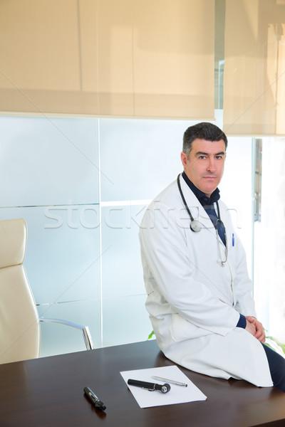 Doctor man expertise portrait casual sitting in hospital office Stock photo © lunamarina