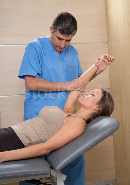 Shoulder physiotherapy doctor therapist and woman patient Stock photo © lunamarina