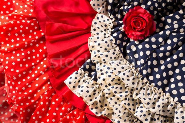 Flamenco dresses in red blue with spot and red rose Stock photo © lunamarina