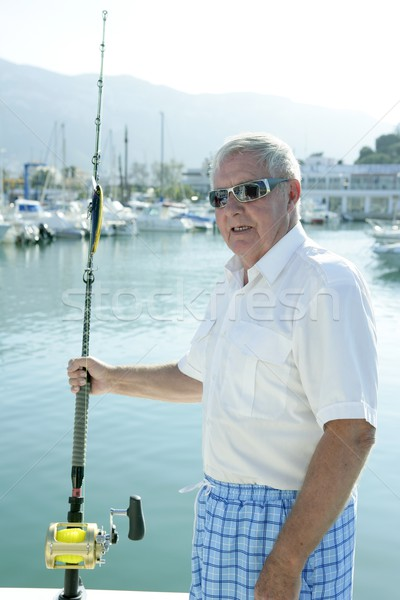Senior boat fisherman white hair, angler fishing rod Stock photo © lunamarina