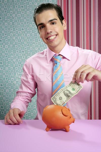 Businessman with piggy bank dollar note Stock photo © lunamarina
