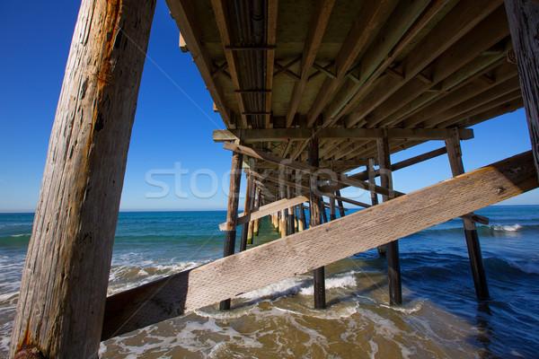 Newport pier beach in California USA from below Stock photo © lunamarina