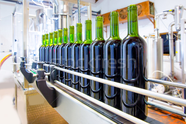 Stock photo: red wine in bottling machine at winery