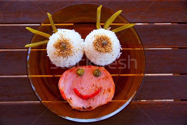Engraçado criança comida arroz carne rosto sorridente Foto stock © lunamarina