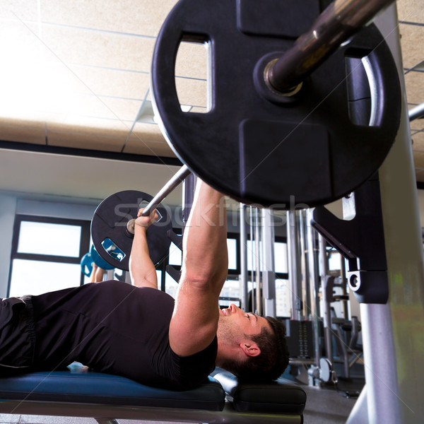 Bench press weightlifting man at gym Stock photo © lunamarina
