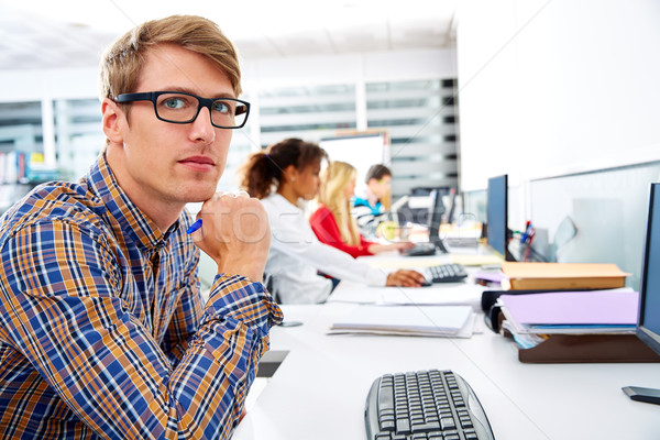 Blond businessman young in office with computer Stock photo © lunamarina