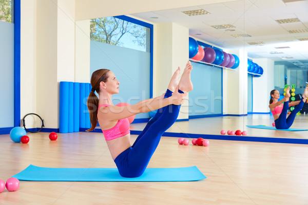 Pilates nő nyitva láb rocker testmozgás Stock fotó © lunamarina