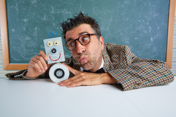 Nerd electronics technician with self made robot Stock photo © lunamarina