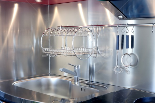 Kitchen silver sink and vitroceramic stove hob Stock photo © lunamarina