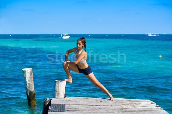 Latin athlete woman stretching in Caribbean Stock photo © lunamarina