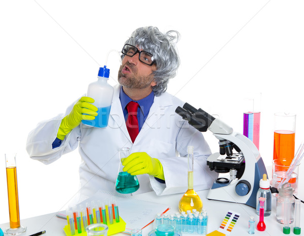 Stock photo: Crazy silly nerd scientist drinking chemical experiment