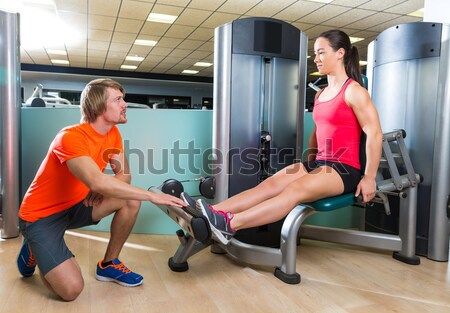 gym with weight lifting bar workout man and woman Stock photo © lunamarina