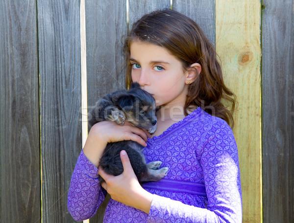 Gyerekek lány csók kutyakölyök kutyus fa Stock fotó © lunamarina