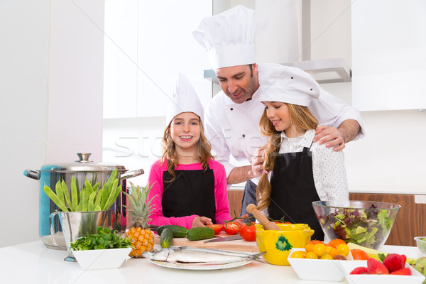 Chef master and junior pupil kid girls at cooking school Stock photo © lunamarina