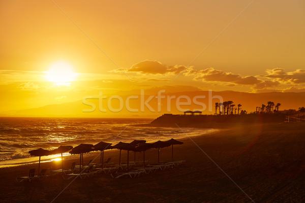 Pôr do sol praia Espanha céu água nuvens Foto stock © lunamarina