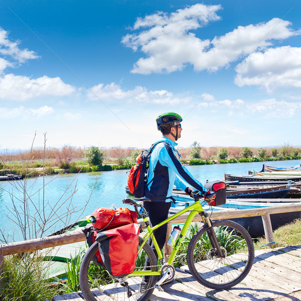 MTB Biker Bicycle touring on the river with pannier Stock photo © lunamarina