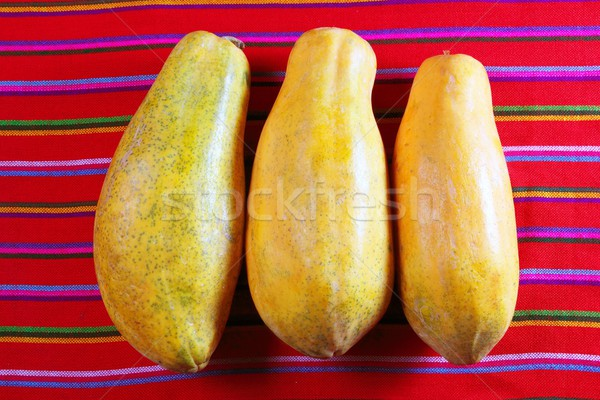 three papaya fruits on latin serape tablecloth Stock photo © lunamarina