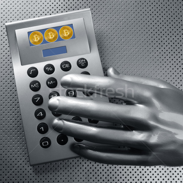 calculator with bitcoin btc coin and futuristic hand Stock photo © lunamarina
