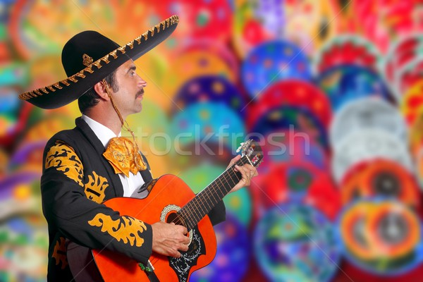 Charro Mariachi playing guitar over colorful blur Stock photo © lunamarina