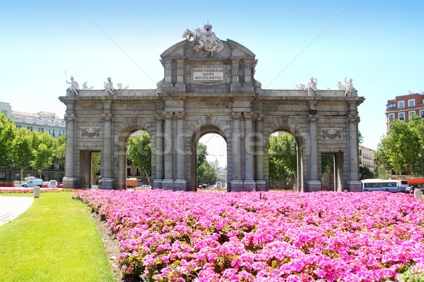Madrid Puerta de Alcala with flower gardens Stock photo © lunamarina