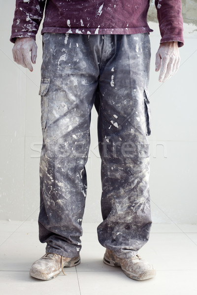 hands dirty trousers of plastering painter man Stock photo © lunamarina