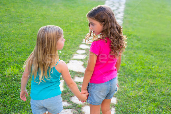 friends sister girls together in grass garden track Stock photo © lunamarina