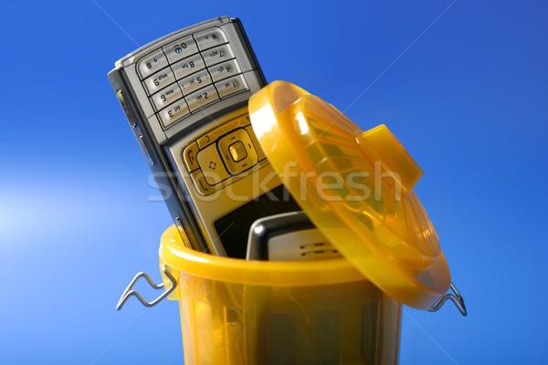 Mobil cell phone on the trash Stock photo © lunamarina