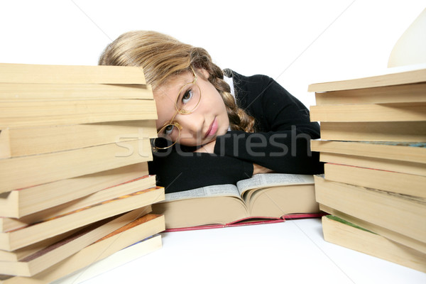Stock photo: little blond bored student girl thinking relaxed on book