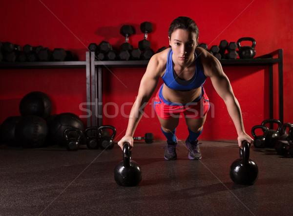 Kettlebells push-up woman strength gym workout Stock photo © lunamarina