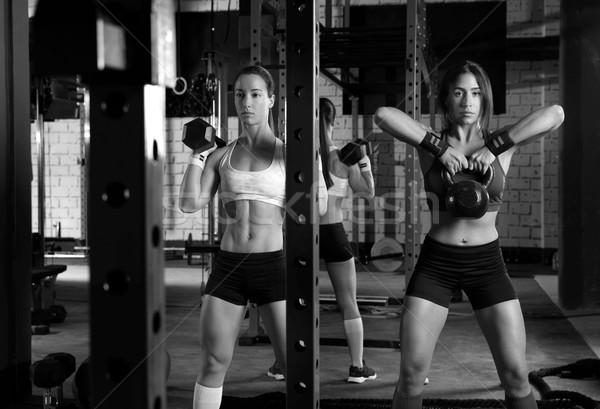 Сток-фото: спортзал · женщины · штанга · гири · тренировки · осуществлять