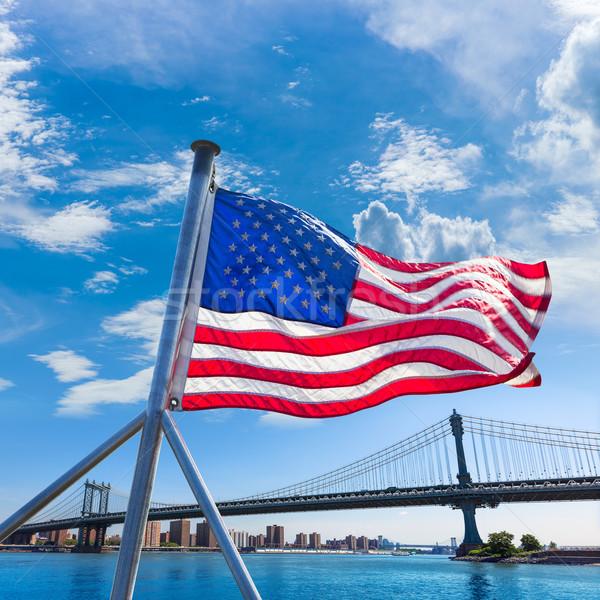 Manhattan Bridge with American flag New York Stock photo © lunamarina